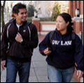 Two students talking as they walk on campus